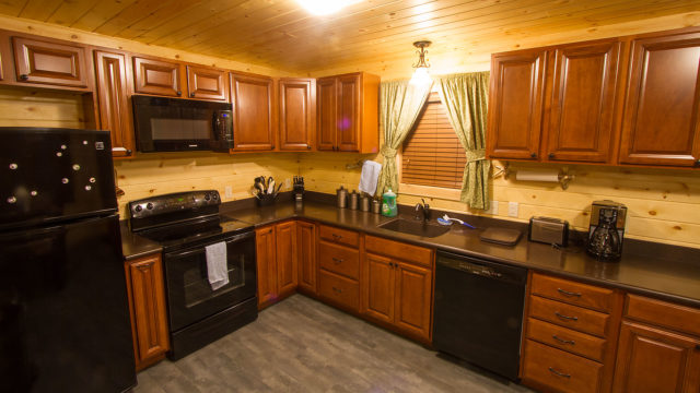 The kitchen has all major appliances, cookware and diningware.