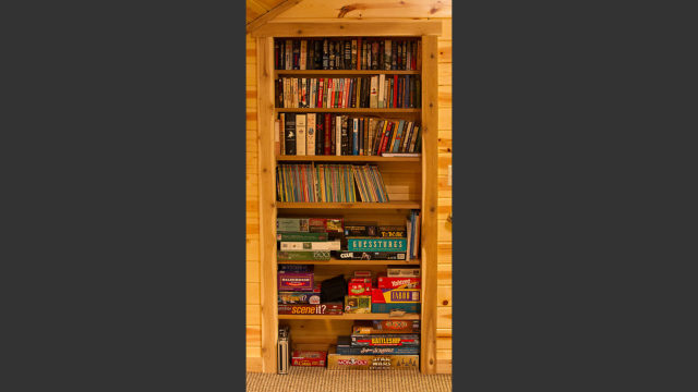 Our library of books and games. The cabin also boasts a large DVD collection.