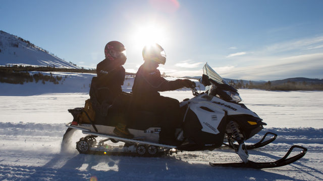 Snowmobilers can ride directly between the cabin and the backcountry.
