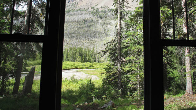 A view of Soda Butte Creek through the dining area window.