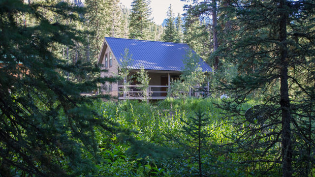 The Ursa cabin is located in a meadow flanked by pines and aspens.