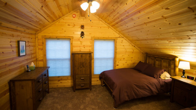 The loft has plenty of room for clothes, with two dressers and an armoire.