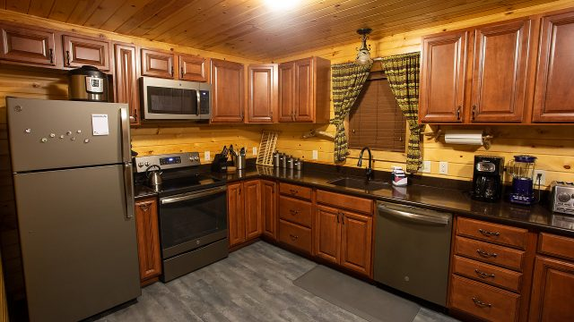The kitchen has all major appliances (updated in 2020), cookware and diningware.